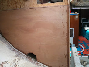 Photo: new bulkhead set in place with epoxy along hull and screws along side and top.