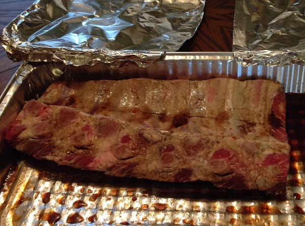 Place beef ribs in a medium to large tin pan. Pour zesty Italian dressing,...