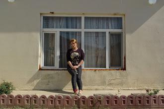 Photo: Behar Hosseini, the poet, in front of her home in Erbil, 2014