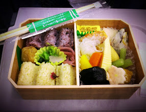 Photo: There are literally dozens of bento boxes to choose from at the train station before boarding a lengthy train ride.  This was Akiko's bento box - 2 different kinds of flavored rice, pickled vegetables, stewed veggies (shiitake mushrooms, bamboo shoot, Japanese rhubarb, carrots, etc), egg, grilled salmon, and fish cake.