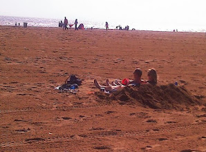 Photo: This couple digging in for some serious R&R. That's the nice thing about the beach, we all own it.