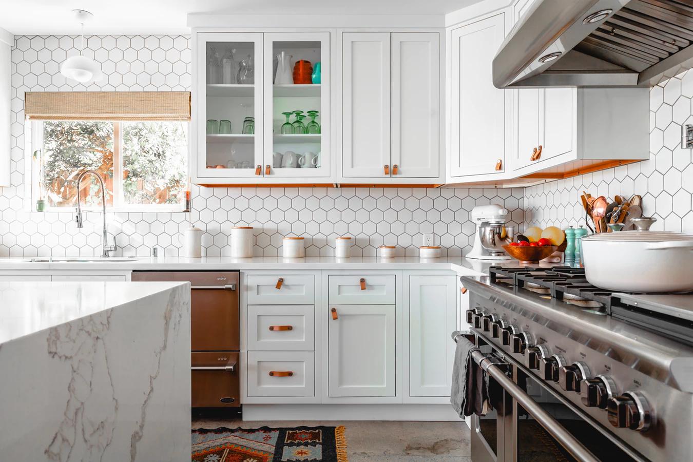A modern kitchen colored bright white