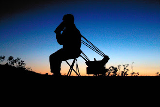 Photo: With the sun down, V sets up the telescope and does a few tests.