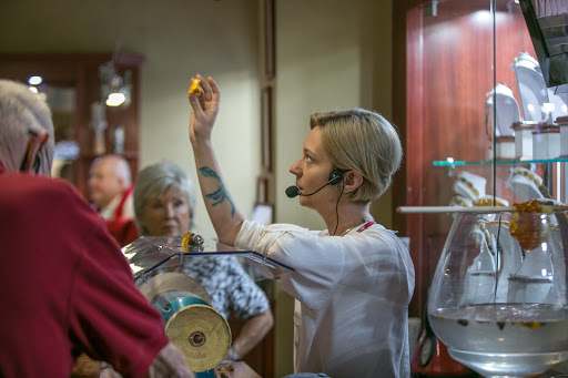Old-Gdansk-amber-shop.jpg - An employee shows off a stone in an amber shop in Old Gdansk, Poland.
