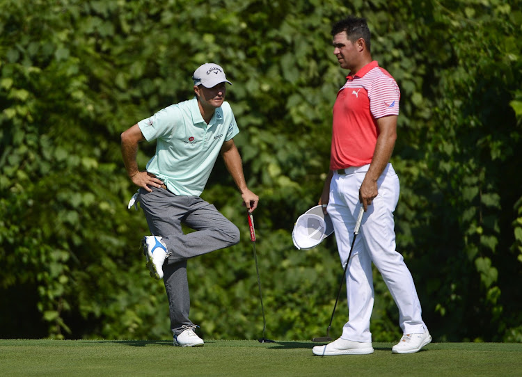 Kevin Kisner (left) and Gary Woodland (right) on the 17th green during the second round of the100th PGA Championship golf tournament at Bellerive Country Club on August 10, 2018 in Saint Louis.