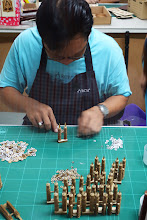 Photo: Making models from pieces of wood.