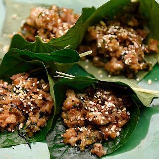 Spicy Pork with Thai Basil in Betel Leaf.