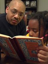 Photo: Kaleya reads to Kalonji 4/23/12