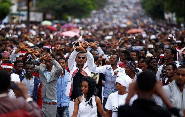 Demonstrators show the Oromo protest sign during a march in Bishoftu, Ethiopia. Picture: REUTERS/TIKSA NEGERI