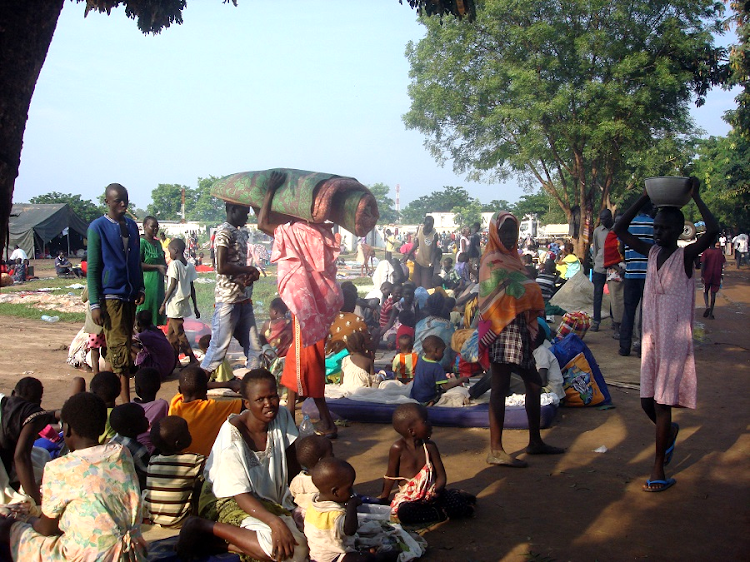 Displaced South Sudanese families arrive at a camp for internally displaced people in the UN Mission in South Sudan (UNMISS) compound in Juba, South Sudan in this file photo. Picture: REUTERS/UN handout
