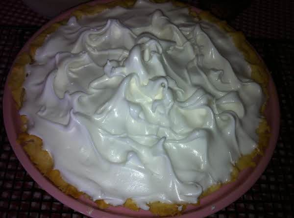 This Meringue Has Not Been Baked Yet.  It Can Always Be Higher!  :)  Just Use More Egg Whites And More Sugar!