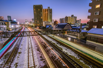 Photo: Trains speed to and from Matsudo Station in Chiba Prefecture, Japan