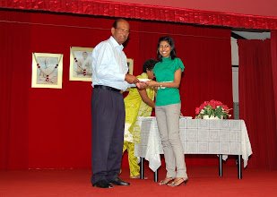Photo: Miss Mshalani receiving the Scholarship Award