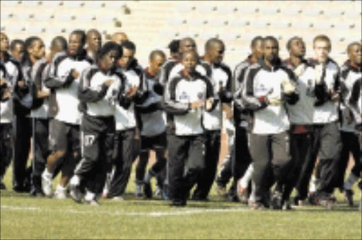 IN RHYTHM: Orlando Pirates players during a training session at Johannesburg Stadium yesterday. Pic. Mohau Mofokeng. 16/07/08. © Sowetan.