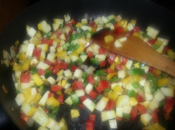 Add all at once: green, yellow and red peppers to the caramelized onion, stir....