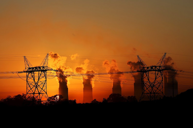 Electricity pylons at an Eskom coal-burning power station near Sasolburg. Picture: REUTERS/SIPHIWE SIBEKO