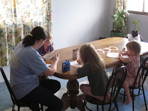 Photo: Coloring while Kaylee reads to them