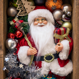 Santa Claus doll in a wooden box with Christmas decoration by Markus Gann - Public Holidays Christmas ( gift, year, balls, greeting, winter, box, santa, smile, red, claus, holidays, white, golden, season, december, man, decoration, new, glass, green, doll, beard, star, belt, tree, brown, christmas, orange, blue, wooden, silver, style, card )