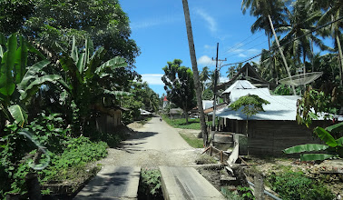 Photo: Tropical jungle, narrow roads, multitudes of bridges, motorcycles, peopleand palm trees & cocoa grovesbest describes our two hour drive.