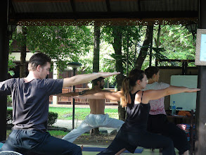 Photo: Daniel teaching the participant to perform Virabhadrasan - The Warrior Pose