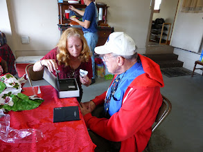 Photo: Opening gifts - Kacey explains how Raymond's new mini-safe works (disguised as an English dictionary)