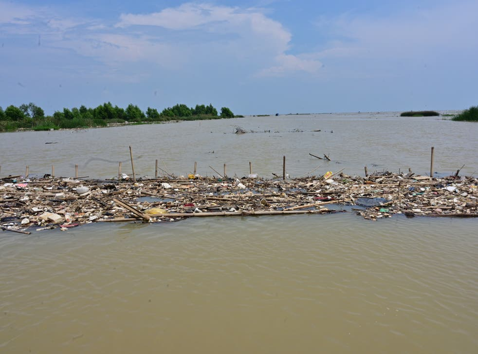 <p>This picture taken in October 2020 shows rubbish floating in the waters off the coast near Teluk Naga</p>