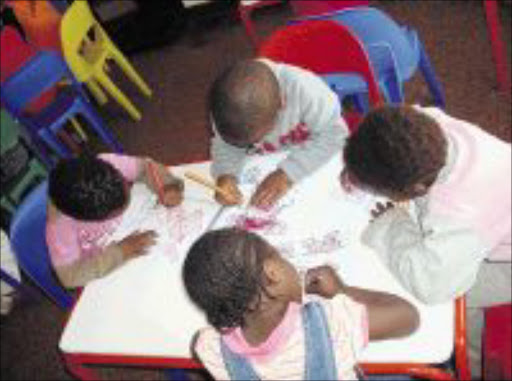 CREATIVE MINDS: Children at the Villa of Hope educentre show off their talents in art by drawing and painting pictures. Pic: Lindi Obose. Circa August 2009. © Sowetan.