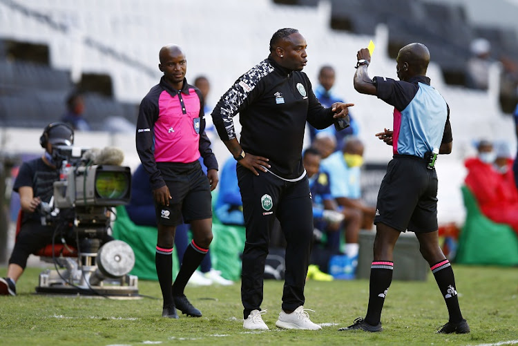 Benni McCarthy (Head Coach) of AmaZulu with Referee Jelly Chavani during the DStv Premiership match between AmaZulu FC and Mamelodi Sundowns at Jonsson Kings Park Stadium on April 21, 2021 in Durban, South Africa.