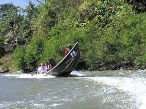 Photo: Speeding along the Pai River on long-tail boats