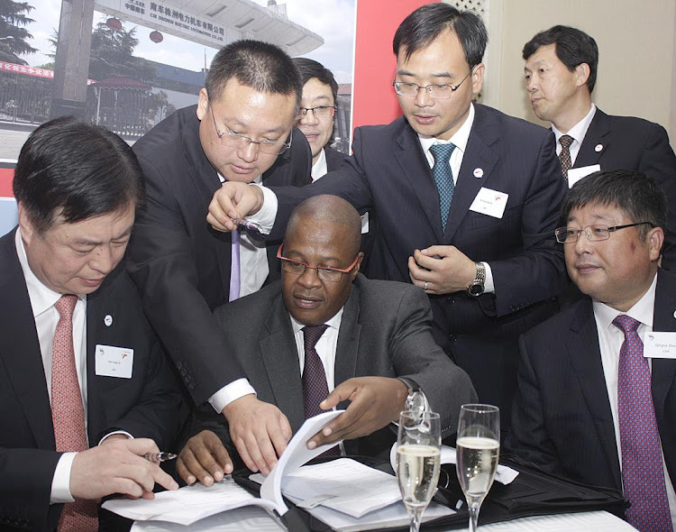 Then Transnet CEO Brian Molefe and representatives of CSR sign a new contract on March 17 2014.Picture: PUXLEY MAKGATHO/BUSINESS DAY