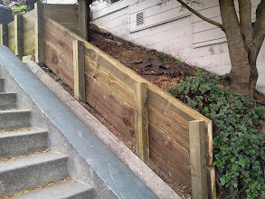 Photo: Most recent addition (July 22, 2013) to San Francisco Department of Public Works (DPW) employees' efforts to add wood retaining walls to control erosion on the Hidden Garden Steps site (16th Avenue, between Kirkham & Lawton streets, in San Francisco's Inner Sunset District). Completion of the retaining walls and repairs on chipped and cracked concrete on the Steps are among the final major tasks to be completed before the 148-step ceramic-tile mosaic by project artists Aileen Barr and Colette Crutcher can be installed. For more information about the Hidden Garden Steps project, please visit http://hiddengardensteps.org and/or follow us on Twitter (@gardensteps), Facebook (Hidden Garden Steps), and Google+.