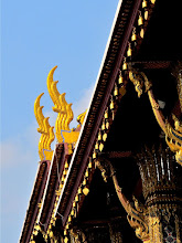 Photo: temple bells and stylized garudas on the roof