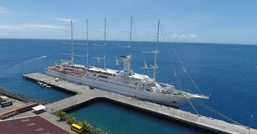 A drone image of Windstar's Wind Surf docked in Dominica.