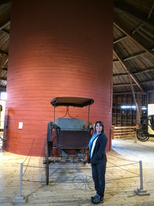 Terri on the 3rd floor in front of the silo inside the barn.