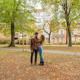 Young couple enjoying the time in the city park by Vera Arsic - People Couples ( young women, romance, two people, heterosexual couple, friendship, city life, togetherness, young adult, embracing, model, hugging, attractive, tree, lovers, lifestyles, girlfriend, enjoyment, color image, green color, love - emotion, weekend activities, adult, photography, handsome, city, 20-29 years, boyfriend, casual clothing, affectionate, modern, romantic, happiness, joy, dating, flirting, caucasian ethnicity, public park, nature, carefree, sexy, intimate, young men, people, young couple, outdoors, bonding, couple relationship, feelings, fun, fashion )