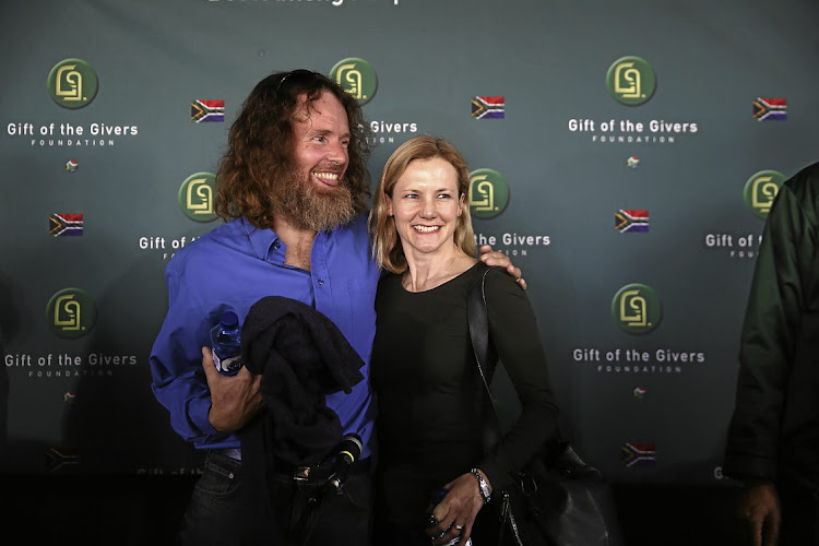 Stephen McGown poses for the cameras with wife Catherine  after being released from  al-Qaeda capture in Mali.
