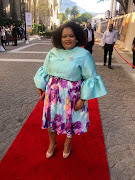 ANC MP Peace Mabe said her outfit for the state of the nation address was designed by Nosipo Daniels from Langa, in Cape Town. Pictured outside parliament in Cape Town on February 7 2019.