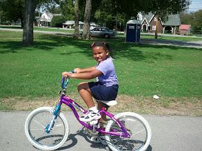 Photo: Kaleya is learning to ride a bike - she has the basics down.