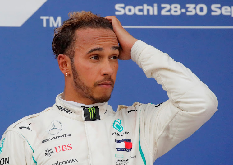 Mercedes' Formula One driver Lewis Hamilton reacts after winning the Russian Grand Priz race in Sochi, Russia, on September 30, 2018.