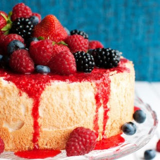 Perfect Angel Food Cake with Raspberry Sauce and Berries.