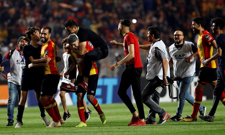 Esperance players celebrate after winning the CAF Champions League in a final match marred by controversy. CAF has ordered a replay.
