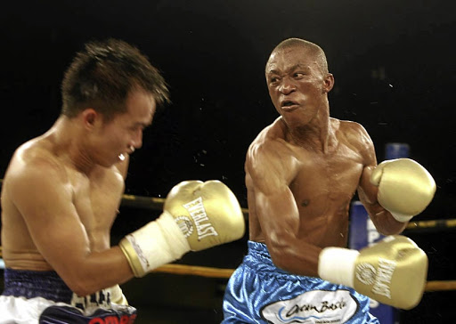 Julius Alcos and Gideon Buthelezi in their IBO minimum weight title fight at Emperors Palace.