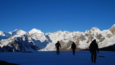 Photo: Kharta Valley, trekkers silouetted against the Himalayas en route to the Lalung La ...