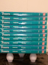 Photo: three carefully placed eggs supports this stack of textbooks