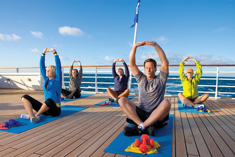 Take a yoga class on the ship's sun deck during your Lindblad Expeditions sailing on National Geographic Explorer.