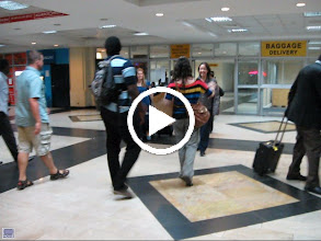 Video: Students arrive at airport.