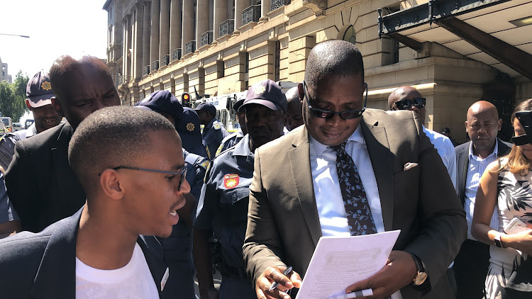 Wits SRC president Thuto Gabaphethe hands over a memorandum of demands to Gauteng MEC for education Panyaza Lesufi saying that provincial government must intervene in the student accommodation crisis.
