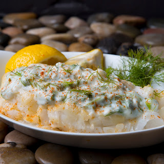 ROASTED GARLIC CHILEAN SEA BASS WITH LEMON DILL DRESSING.