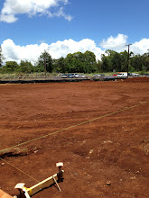 Photo: If you look closely, you can see a bright green string in the shape of a rectangle.  This is the area where the administration building will be built.