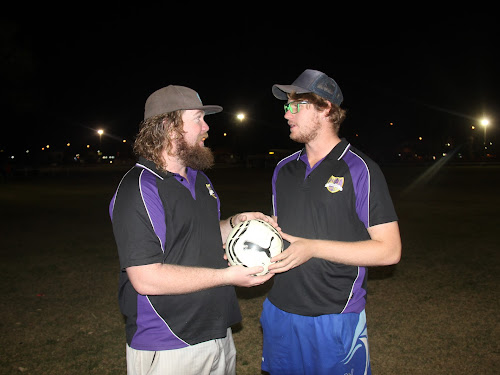 Brendan and Brady Jenkins talking tactics last night. The sons of the late David Jenkins, who Saturday's game will be played in memory of, will line up for Crossroads Eleven FC against Narrabri FC.